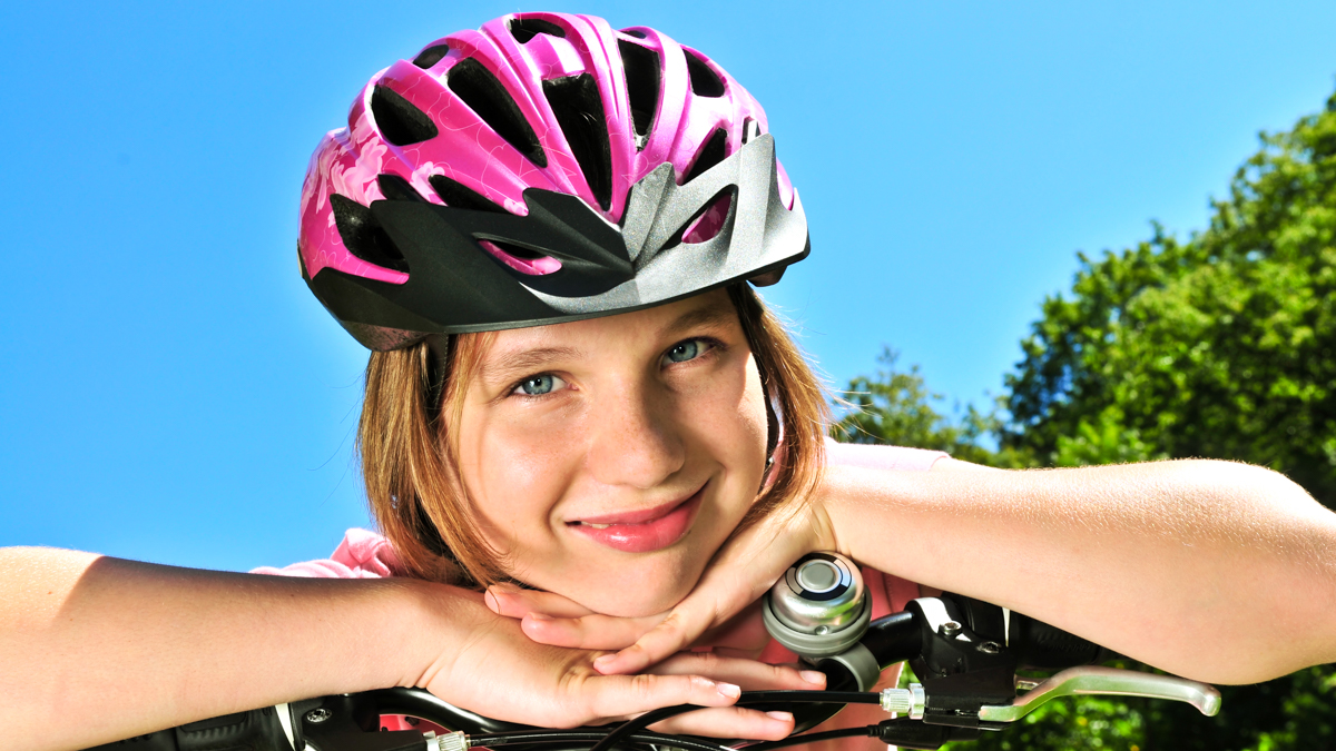 A girl with a bicycle helmet.